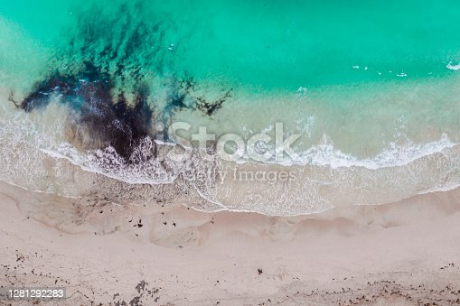 Aerial view of the beach and the water flowing with some dirt.
