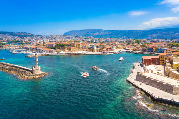 Aerial view of the beautiful city of Chania with it's old harbor and the famous lighthouse, Crete, Greece. stock photo