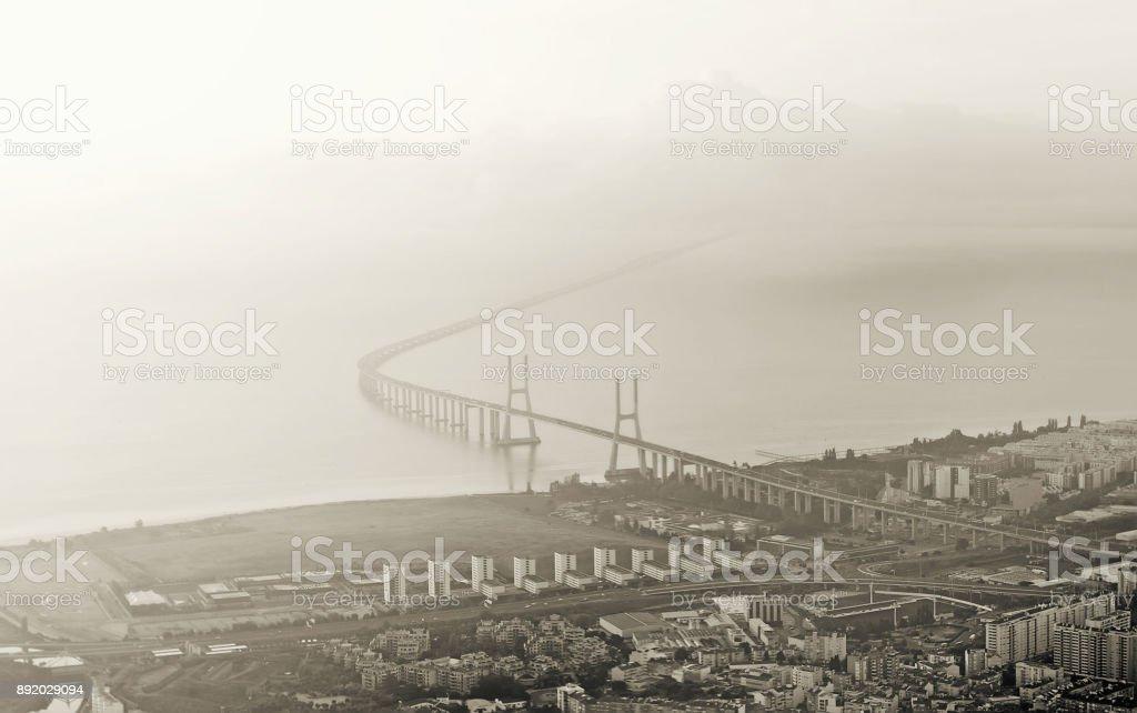 Aerial view of the bridge Vasco da Gama in Lisbon. Black and white image. stock photo