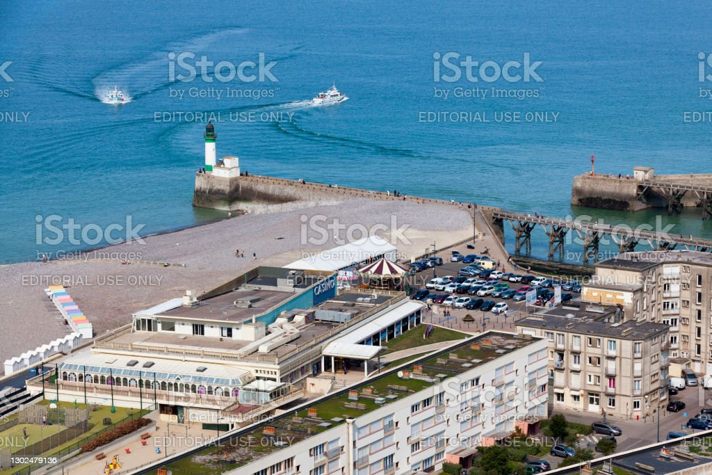 Aerial view of the Casino Joa in the Treport Le Tréport, France - September 11 2020: Aerial view of the Casino Joa du Tréport near the lighthouse on the jetty. Aerial View Stock Photo
