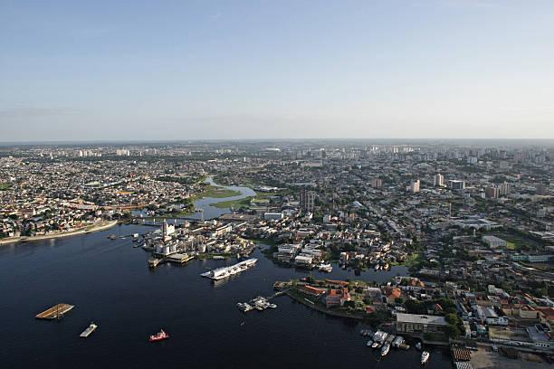 Aerial view of the city of Manaus in Brazil Vista aérea do centro da cidade de Manaus, mostrando a área da manaus moderna e o Rio Negro. rio negro brazil stock pictures, royalty-free photos & images