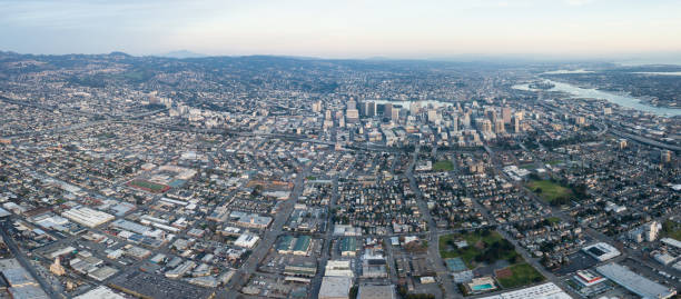 Aerial View of the City of Oakland, California Incorporated in 1852, the city of Oakland is the eighth most populated city in California and serves as an important port and trade center. It lies just across the bay from San Francisco. alameda california stock pictures, royalty-free photos & images