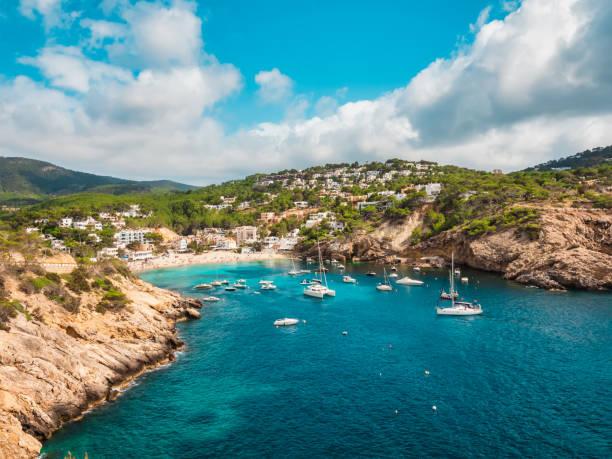 aerial view of the cliffs and the beach of cala vadella, ibiza, spain - ibiza imagens e fotografias de stock