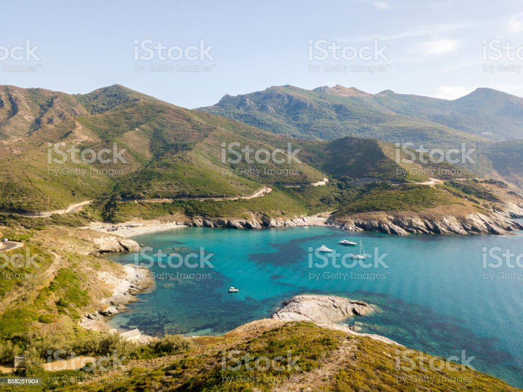 Aerial view of the coast of Corsica, winding roads and coves with crystalline sea. Cap Corse Peninsula, Corsica. Coastline. Anse d'Aliso. Gulf of Aliso. France stock photo