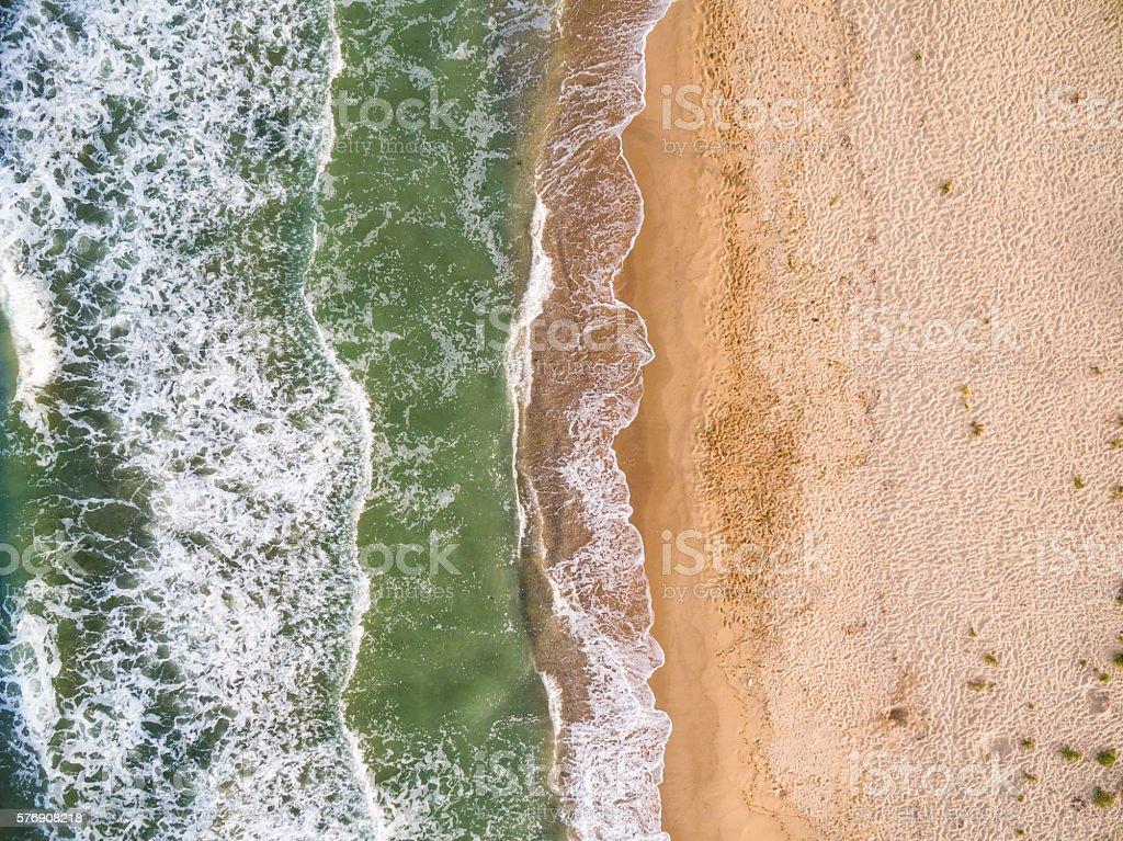 Aerial view of the coastline with algae stock photo