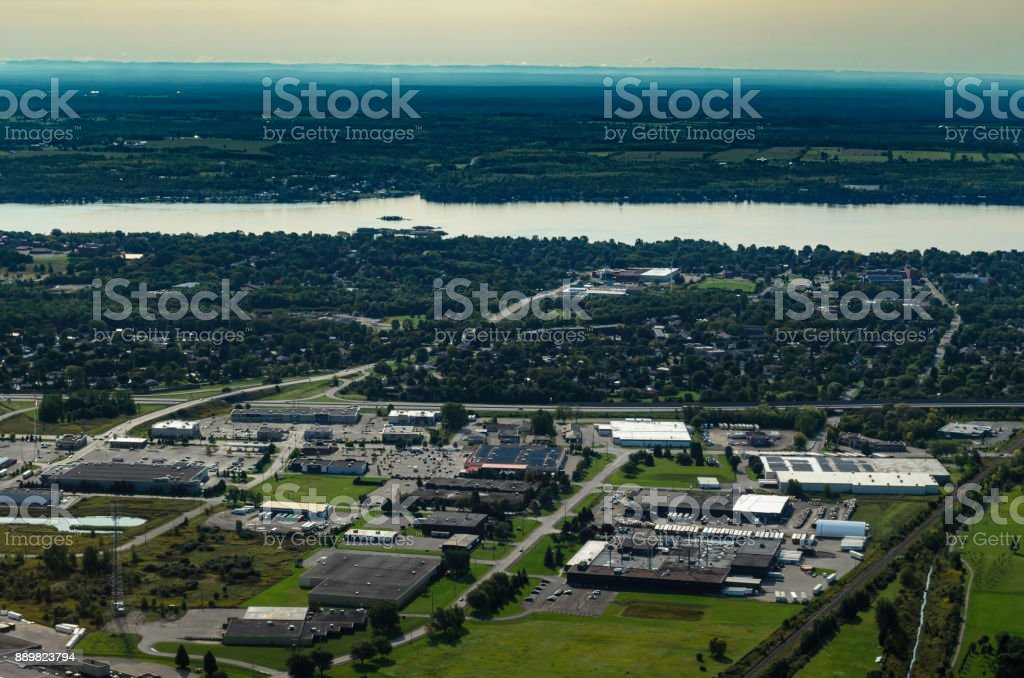 Aerial view of the Commercial/Retail area of Brockville, Ontario with the St. Lawrence River and New York State in the background. stock photo