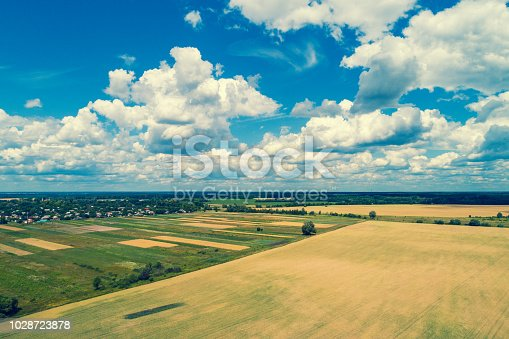 1155573645istockphoto Aerial view of the countryside and arable fields 1028723878