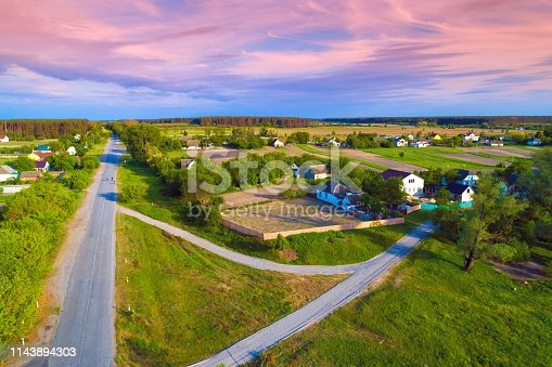 1155573645istockphoto Aerial view of the countryside. Country roads, and village 1143894303