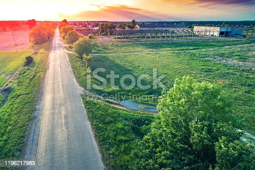 1155573645 istock photo Aerial view of the countryside. The direct country road along the field 1196217983