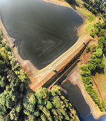 istock Aerial view of the dam between two ponds in the Harz Mountains. 1060941406