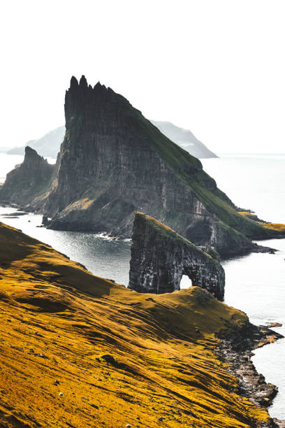 aerial view of the dranganir rock at the faroe islands - rock formations stock pictures, royalty-free photos & images