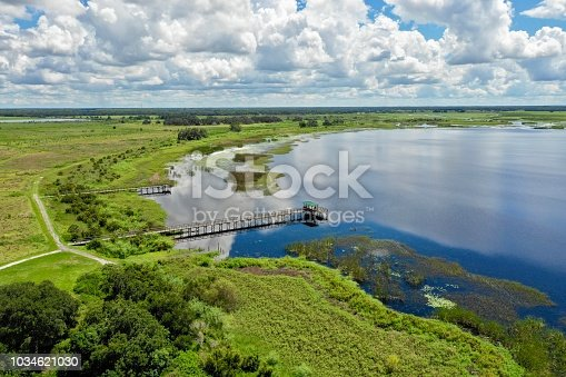View of the Everglades in Florida on a sunny day with reflection in the water