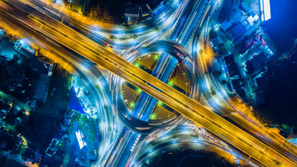Aerial view of the expressway, motorway and highway in circle Aerial view of the expressway, motorway and highway in circle road intersection stock pictures, royalty-free photos & images