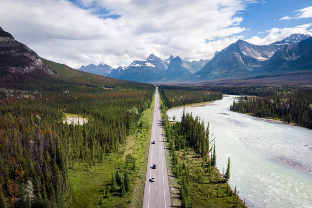 Aerial View of the Famous Icefields Parkway Road Between Banff and Jasper National Parks in Alberta, Canada Aerial view of the famous Icefields Parkway road between Banff and Jasper National Parks in Alberta, Canada. alberta stock pictures, royalty-free photos & images