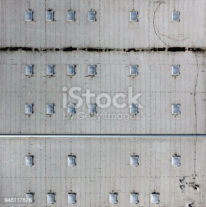 Aerial view of the flat roof of an industrial hall, as background, made with drone