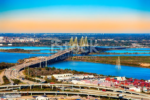 The Fred Hartman Bridge spanning the San Jacinto Bay in Baytown, Texas located in Harris County just outside of Houston with the Port of Houston in the foreground.