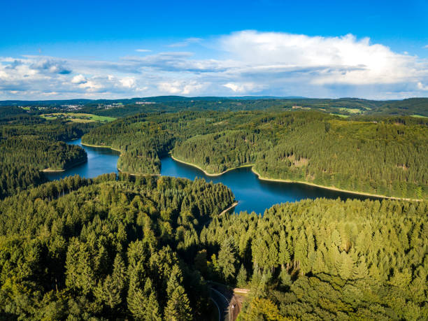 Aerial view of the Genkeltalsperre (Genkel dam). The Genkeltalsperre (Genkel dam) is a pure drinking water dam and is located in the urban areas of Gummersbach and Meinerzhagen. Aerial view of the Genkeltalsperre (Genkel dam). The Genkeltalsperre (Genkel dam) is a pure drinking water dam and is located in the urban areas of Gummersbach and Meinerzhagen. north rhine westphalia stock pictures, royalty-free photos & images