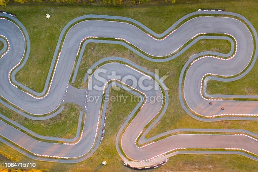 Aerial view of the go-kart track. New asphalt track with turns for racing.