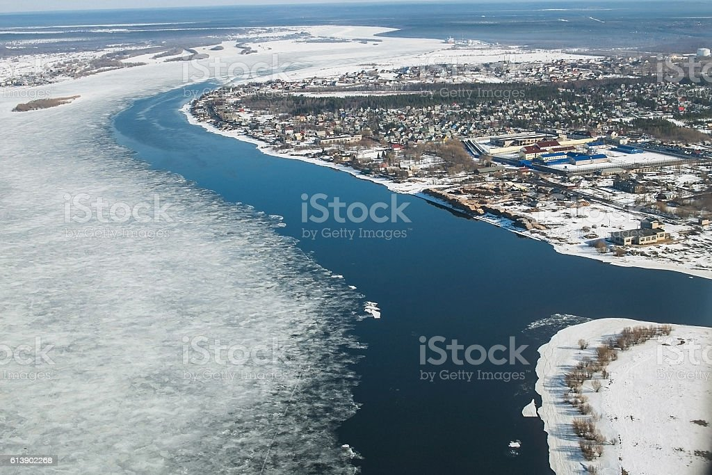 Aerial view of the great river with floating ice floes stock photo