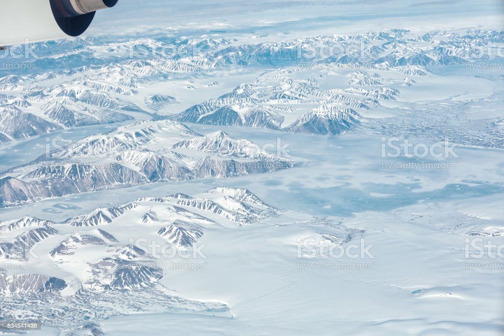 Aerial view of the Greenland with mountain, ocean and ice holes stock photo