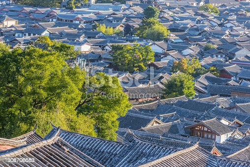 Aerial view of the historical city center at sunrise. Lijiang. China.