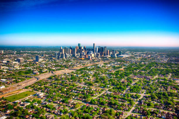 Aerial View of the Houston Metropolitan Area. The urban downtown and surrounding areas of Houston, Texas from above during a helicopter photo flight. urban sprawl stock pictures, royalty-free photos & images