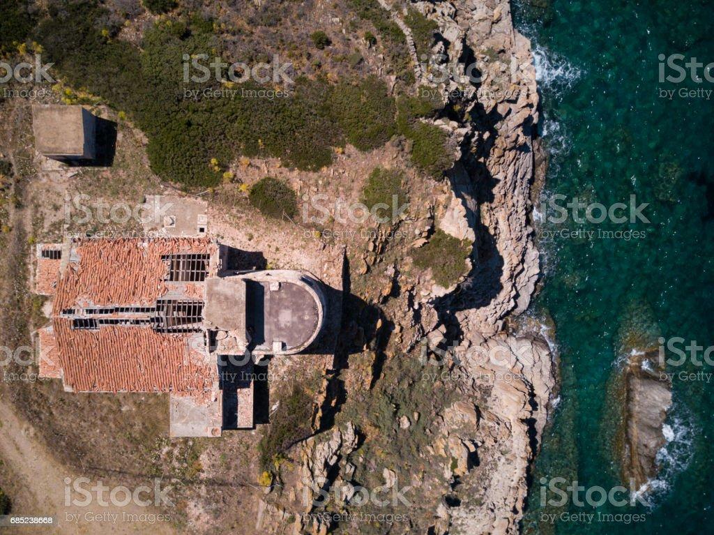 Aerial view of the Italian coast at sunset With a lighthouse on the Mediterranean sea. Porto Cervo - Emerald coast, Sardinia - Italy royalty-free stock photo