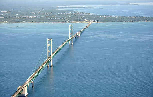 aerial view of the mackinac bridge, michigan, usa - mackinac island stock photos and pictures