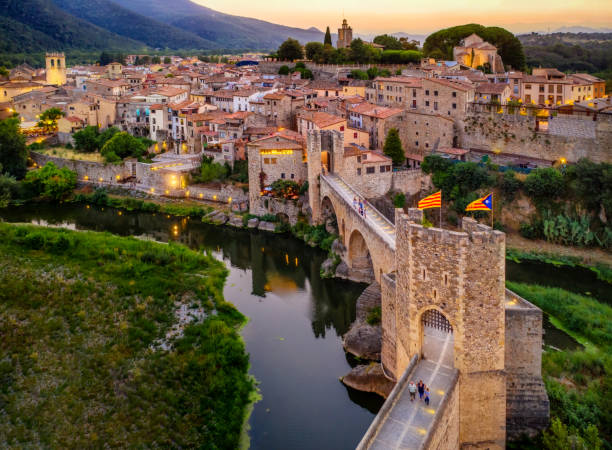 aerial view of the Medieval bridge of the Besalu at dusk. Catalonia, Spain stock photo