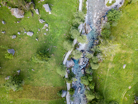 Aerial view of the Mello Valley, Val di Mello, a green valley surrounded by granite mountains and forest trees, renamed the little italian Yosemite Valley. Italy