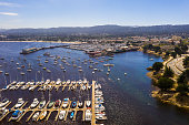 Aerial view of the Monterey town in California near Monterey Bay Aquarium with many yachts by the Pacific ocean.