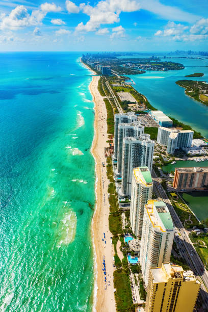 Aerial View of the North Miami Beach Florida Coastline The view from North Miami Beach south across the Biscayne Bay with the skyline of downtown Miami in the distance. miami beach stock pictures, royalty-free photos & images