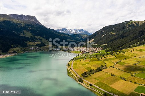 Curon, Italy. Drone aerial view of the old bell tower of the village rising out of the waters lake