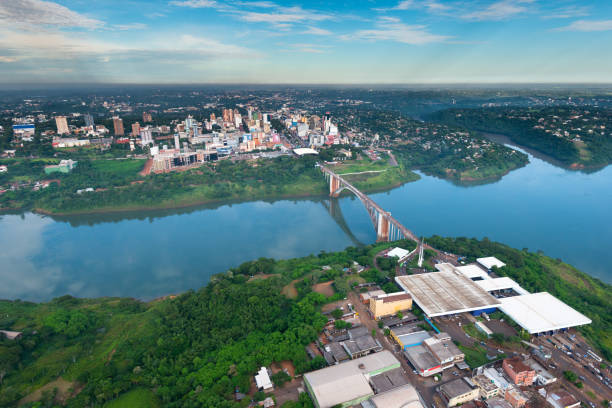 Aerial view of the Paraguayan city of Ciudad del Este and Friendship Bridge stock photo