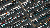 fantastic flight over parked new cars at the car building enterprise at sunset, smooth rows of cars