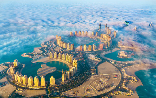 Aerial view of the Pearl-Qatar island in Doha through the morning fog - Qatar, the Persian Gulf stock photo