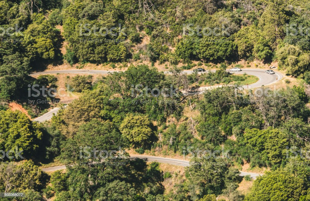 Aerial view of the picturesque forest and winding road in Sequoia National Park, California, USA stock photo