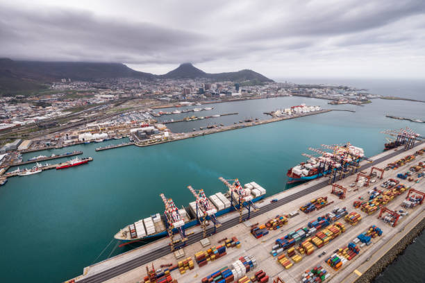 Aerial view of the port with moored container vessels being loaded in the Ben Schoeman Dock showing the city and Table Mountain, Cape Town South Africa stock photo