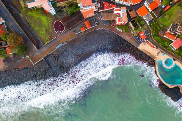 aerial view of the porto da cruz town - rain clouds porto portugal imagens e fotografias de stock