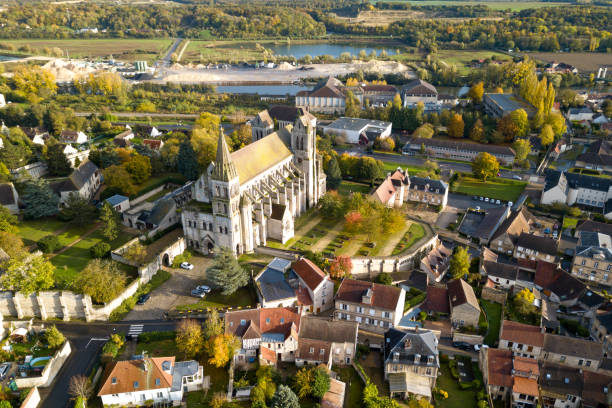 Aerial view of the Priory Church of Saint-Leu-d'Esserent The Church of St. Nicholas (French: Église Saint-Nicolas), also known as Priory Church of Saint-Leu-d'Esserent (French: Église prieurale de Saint-Leu-d'Esserent) is a church of Romanesque and Gothic styles located in the town of Saint-Leu-d'Esserent, in the French department of Oise and the region Hauts-de-France. It is a former priory church, built between the mid-twelfth century and the first quarter of the thirteenth century for the monks of the Cluniac priory of Saint-Leu founded in 1081 by Hugues de Dammartin. picardy stock pictures, royalty-free photos & images