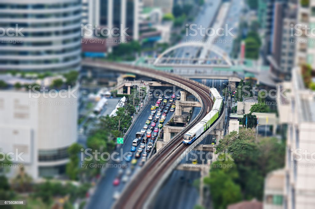 Aerial view of the rail way sky train over traffic road in Bangkok city, tilt-shift effect. stock photo