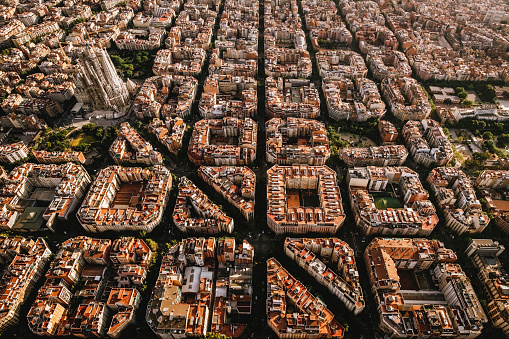 Aerial view of the residential Eixample district of Barcelona, with the Sagrada Familia, Designed by Catalan architect Antoni Gaudi