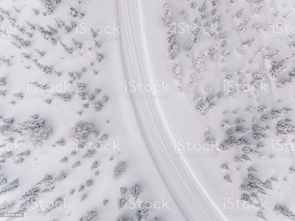 Aerial view of the road in the winter snow forest in Finland stock photo