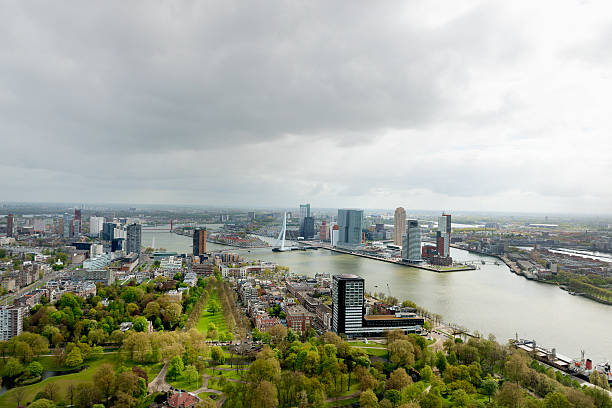 Aerial view of the Rotterdam skyline Rotterdam skyline with a dramatic sky with the Erasmus bridge. meuse river stock pictures, royalty-free photos & images