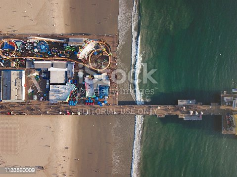 The Santa Monica Pier and amusement part is a large double-jointed pier at the foot of Colorado Avenue in Santa Monica, California, USA. With an iconic entrance, the pier is popular with residents and visitors as a landmark that is over 100 years old.