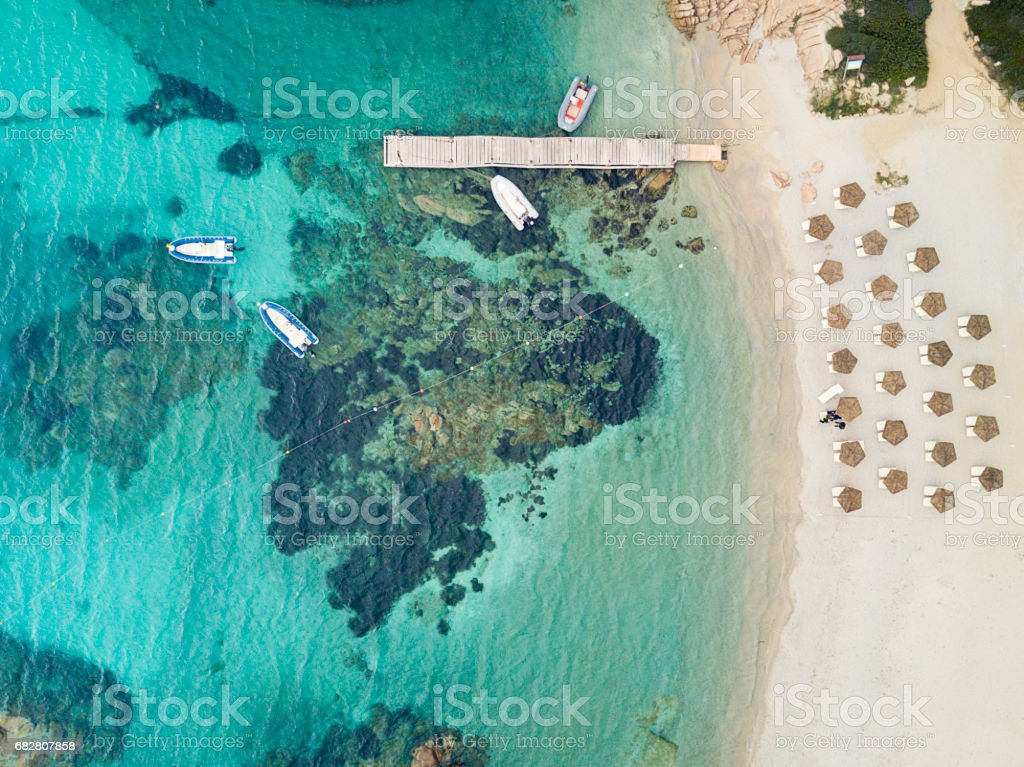 Aerial view of the Sardinian Emerald Coast, with its turquoise sea. Costa Smeralda in Sardinia Island, is one of the most beautiful and famous coasts in the world стоковое фото