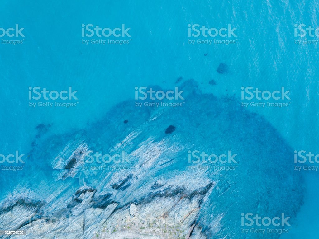 Aerial view of the sea and the rock stock photo
