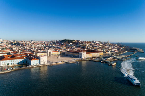 Aerial view of the skyline of the city of Lisbon with the Comercio Square, the Alfama Neighbourhood and the Tagus River stock photo