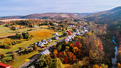 istock Aerial view of the small town surrounded by the forest in the mountain in autumn morning. 1266362606