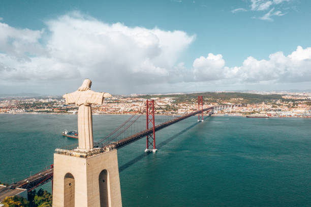 "aerial view of the statue of ""cristo-rei"" in lisbon - cristo rei lisboa imagens e fotografias de stock"